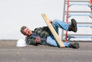 Injured construction worker fallen off ladder