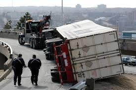 18 wheeler turned over on highway